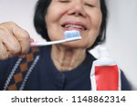 asian elderly woman trying use... | Shutterstock . vector #1148862314