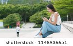 woman use of mobile phone at...   Shutterstock . vector #1148936651