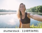 sporty young woman takes selfie ...   Shutterstock . vector #1148936981
