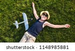 teenager playing with a plane | Shutterstock . vector #1148985881