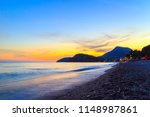 awesome sunset on the adriatic... | Shutterstock . vector #1148987861