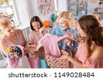 baby clothes. three friendly...   Shutterstock . vector #1149028484