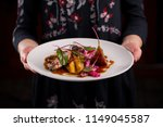 duck breast served with... | Shutterstock . vector #1149045587