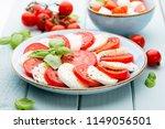 tomatoes  mozzarella cheese ... | Shutterstock . vector #1149056501