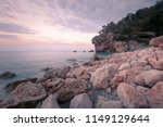 beautiful rocky beach at sunset ... | Shutterstock . vector #1149129644