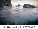 rocky beach seascape at sunset... | Shutterstock . vector #1149129647