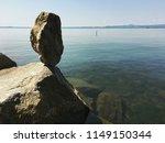 Rock Balanced On The Lake Shore