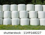 stacked round silage bales... | Shutterstock . vector #1149168227