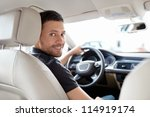 The young man behind the wheel - stock photo
