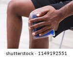 close up of a man applying ice... | Shutterstock . vector #1149192551