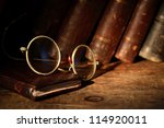 Old Spectacles On Leather...
