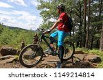 mountain biker enjoying the vie | Shutterstock . vector #1149214814