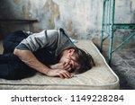 male drug addict sleeping in... | Shutterstock . vector #1149228284