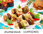 herring skewers with prune,gherkin and mustard for christmas - stock photo