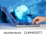 hand using laptop with global... | Shutterstock . vector #1149402077