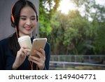 woman drinking coffee listening ... | Shutterstock . vector #1149404771