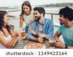 friends enjoying pizza. group... | Shutterstock . vector #1149423164