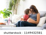 young pregnant woman  reading a ... | Shutterstock . vector #1149432581