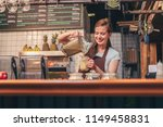 young chef preparing smoothies... | Shutterstock . vector #1149458831