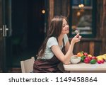 young woman eating in the... | Shutterstock . vector #1149458864