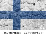 finland flag on a stone wall | Shutterstock . vector #1149459674