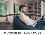 smiling man with laptop in... | Shutterstock . vector #1149459791