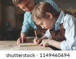 father and son at work in the... | Shutterstock . vector #1149460694