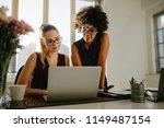 portrait of two businesswomen...   Shutterstock . vector #1149487154