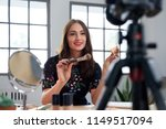 pretty beauty vlogger recording ... | Shutterstock . vector #1149517094
