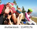 Friends on halt in hike - stock photo