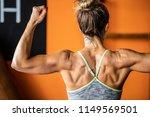 muscular woman flexing her... | Shutterstock . vector #1149569501