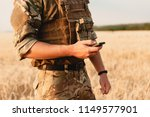 mid section of military soldier ... | Shutterstock . vector #1149577901