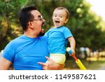 young bearded father together... | Shutterstock . vector #1149587621