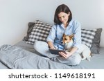 Stock photo domestic cozy atmosphere beatiful female model wears pyjmas sits on bedclothes in bedroom with 1149618191