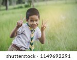 kid scout stand and lift finger ... | Shutterstock . vector #1149692291