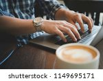 hands of man using laptop in... | Shutterstock . vector #1149695171