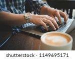 hands of man using laptop in... | Shutterstock . vector #1149695171