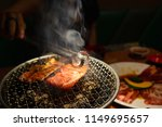 beef barbecue on mesh grill of... | Shutterstock . vector #1149695657