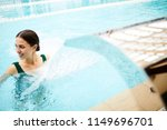 serene girl in swimsuit... | Shutterstock . vector #1149696701