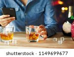 man using smartphone while... | Shutterstock . vector #1149699677