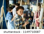 young mixed race boy with color ... | Shutterstock . vector #1149710087