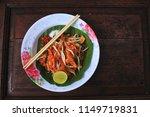 pad thai is thai food on old... | Shutterstock . vector #1149719831
