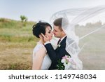 a stylish bridegroom embraces a ... | Shutterstock . vector #1149748034