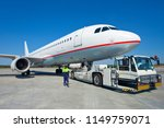 the pushback tractor is towing... | Shutterstock . vector #1149759071