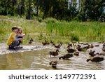 little boy and girl feeding...   Shutterstock . vector #1149772391
