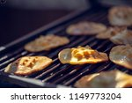 baked sheep cheese on a grill... | Shutterstock . vector #1149773204