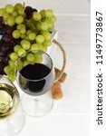 red and white wine and grapes | Shutterstock . vector #1149773867