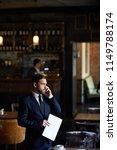 confident handsome restaurant...   Shutterstock . vector #1149788174