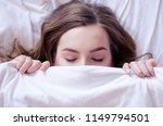 beautiful young woman lying... | Shutterstock . vector #1149794501