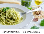 spaghetti with homemade pesto... | Shutterstock . vector #1149808517